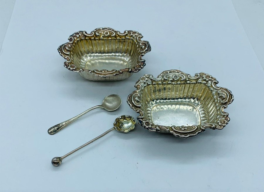 Lot 16 - Two small silver salts with spoons.
