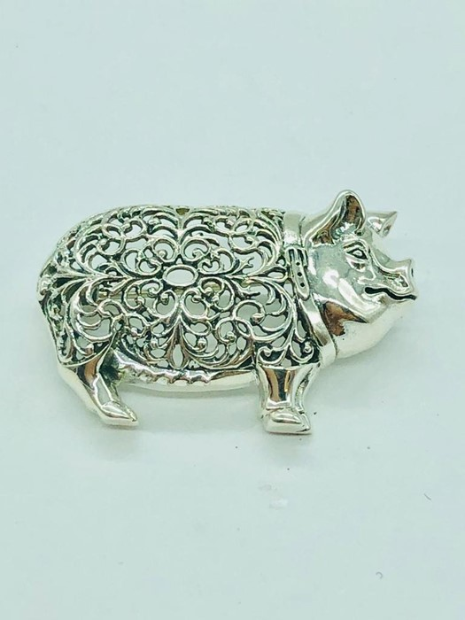 Lot 34 - A silver brooch in the form of a pig