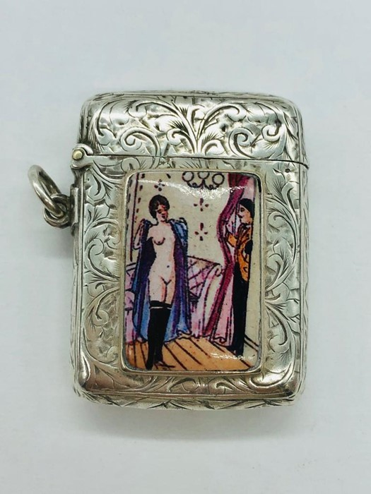 Lot 42 - A silver vesta case with enamel plaque