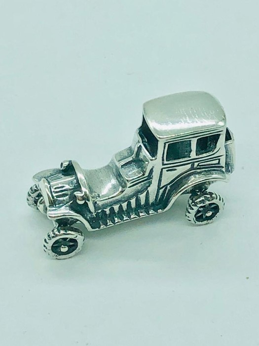 Lot 38 - A sterling silver figure of a classic car