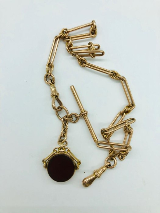 Lot 43 - A 9ct gold Albert watch chain, makers mark K & D along with a swivel fob by JTJ.