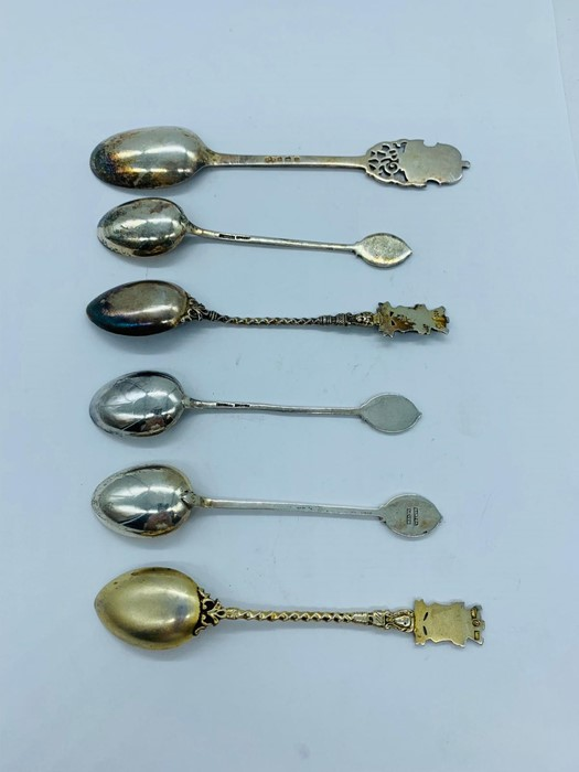 Lot 10 - A small selection of collectable silver spoons, some with enamel