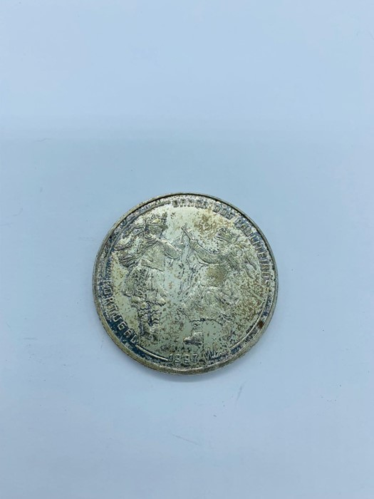 Lot 108 - : A 1000 Escudos silver coin from Portugal