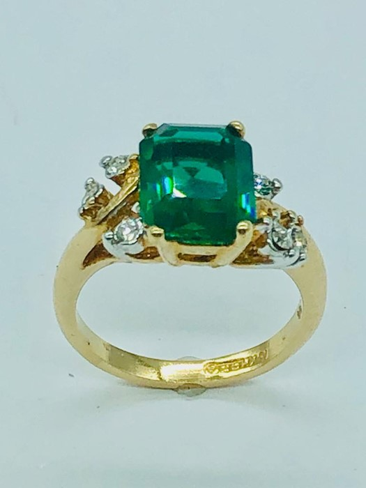 Lot 62 - An 18ct gold Emerald and Diamond Ring (size M)