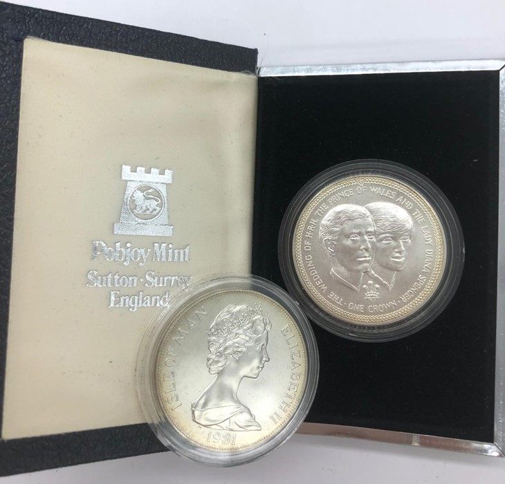 Lot 102 - Presentation pack of two Sterling silver crowns celebrating the Marriage of the Prince of Wales