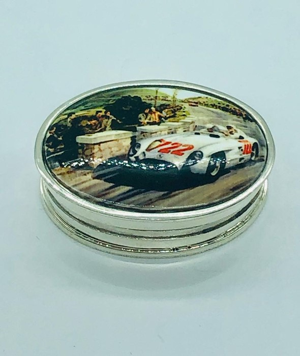 Lot 28 - A silver pill box with enamel lid depicting a vintage race car