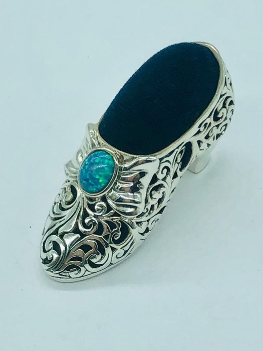 Lot 29 - A large silver Victorian shoe style pincushion with opal cabochon