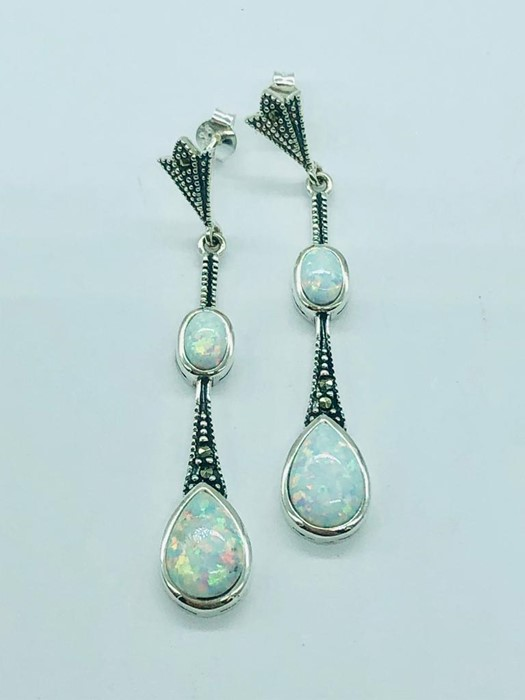 Lot 93 - A pair of silver and opal drop earrings
