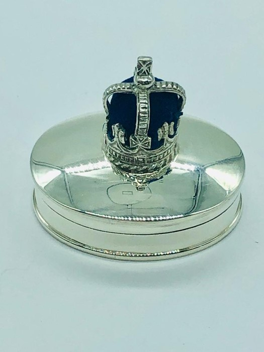 Lot 26 - A silver pill box with crown shaped pincushion to the lid