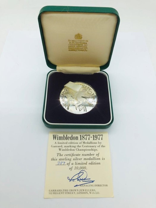 Lot 4 - A Limited Edition Medallion by Garrard in Sterling Silver celebrating the Centenary of the Wimbledon