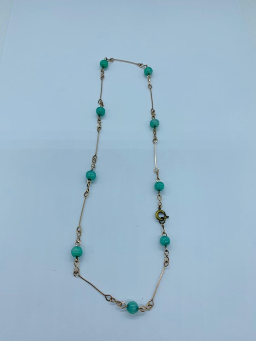 Lot 80 - A Jade and Gold necklace