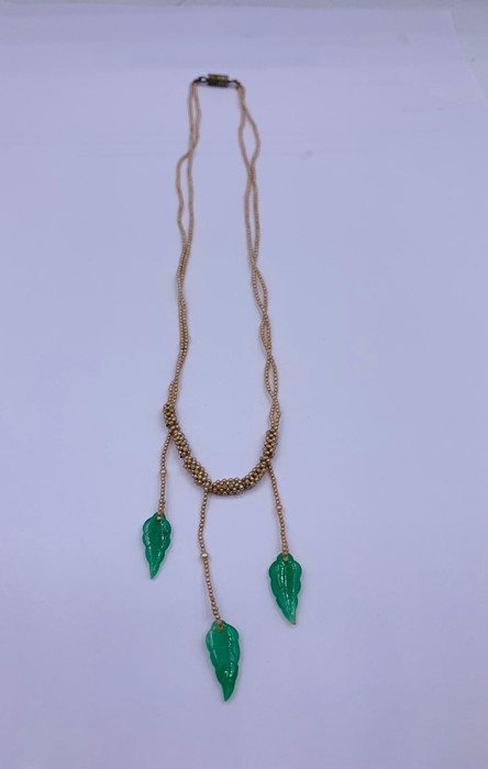 Lot 48 - A Chinese jade and seed pearl necklace