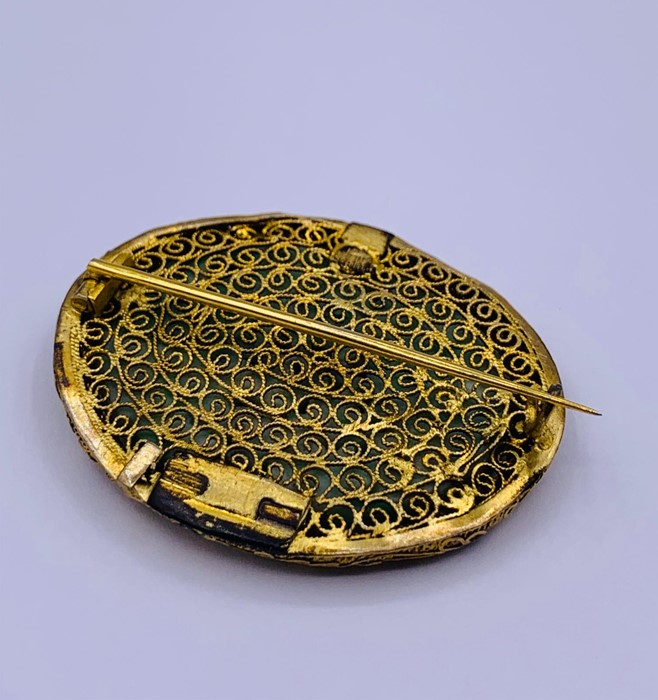 Lot 44 - A Chinese jade and gold Brooch with floral design