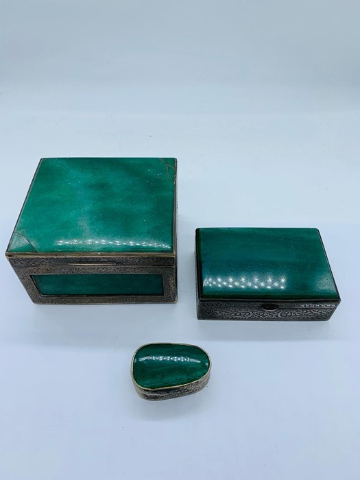 Lot 17 - Three pieces of Indian white metal boxes with intricate designs
