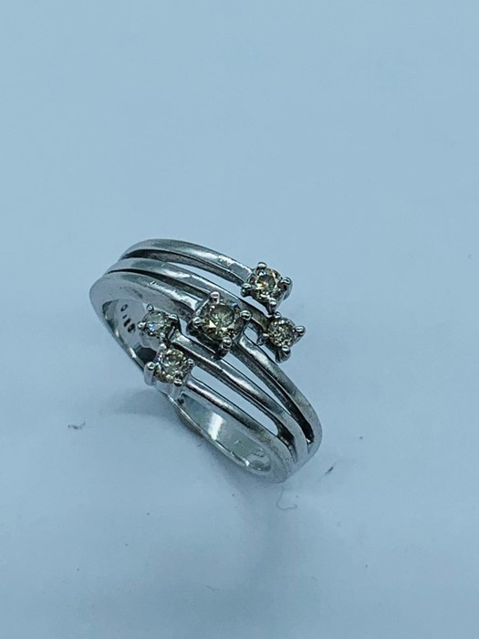 Lot 70d - A 9ct white gold five stone ring (3.6g)