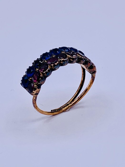 Lot 45 - A Cocktail ring with blue and pink stones AF