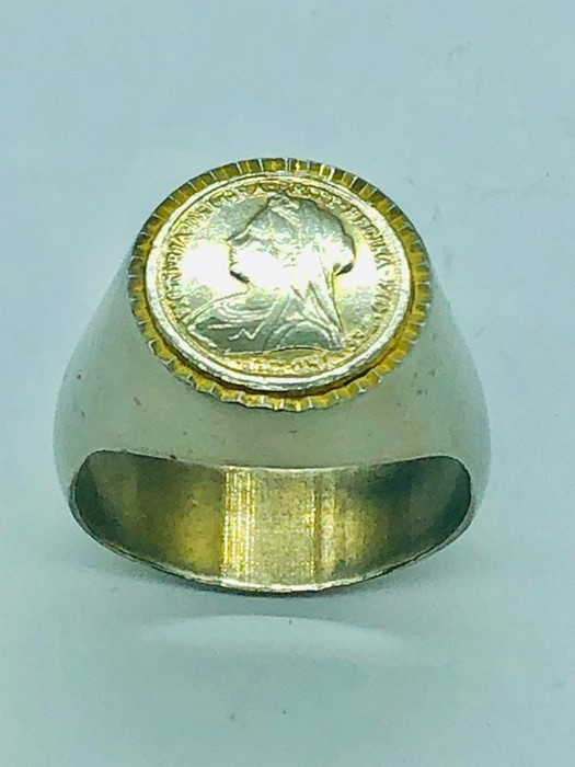Lot 41 - A Signet ring with a Victorian mounted coin, white metal.