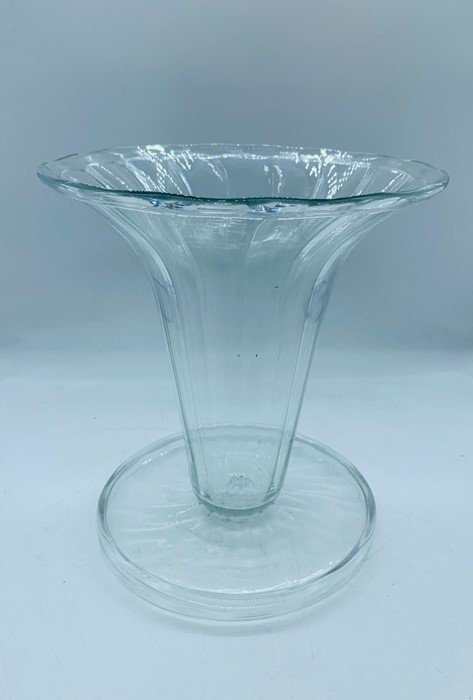 Lot 148 - A James Powell Optic Moulded Flared vase design no 916 Etched reg no to base for 1908 H 22cms