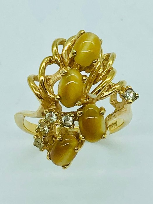 Lot 64 - A Cocktail ring by Napier.