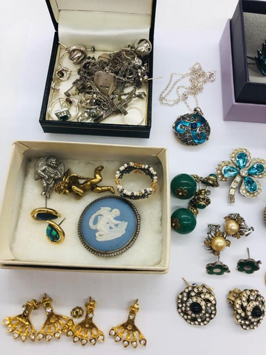 Lot 63 - A Volume of costume and silver jewellery