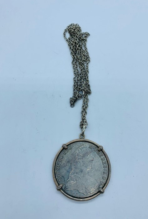 Lot 105 - A Maria Theresa coin on a silver chain