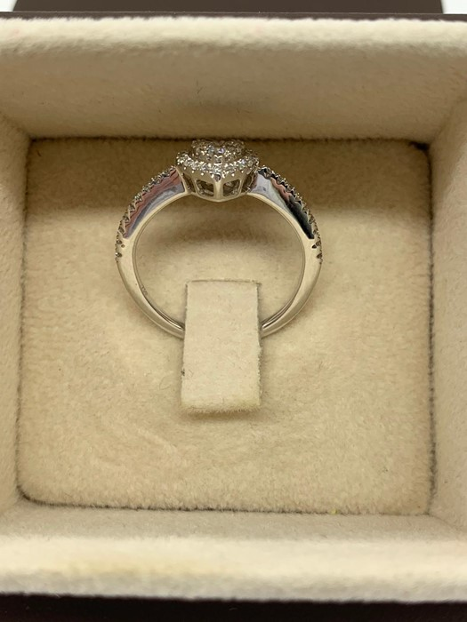 Lot 98 - A Heart Shaped diamond ring on a white gold band 0.34ct. Size K