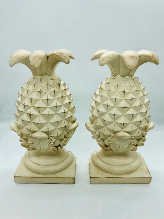Lot 170 - A pair of resin pineapple bookends