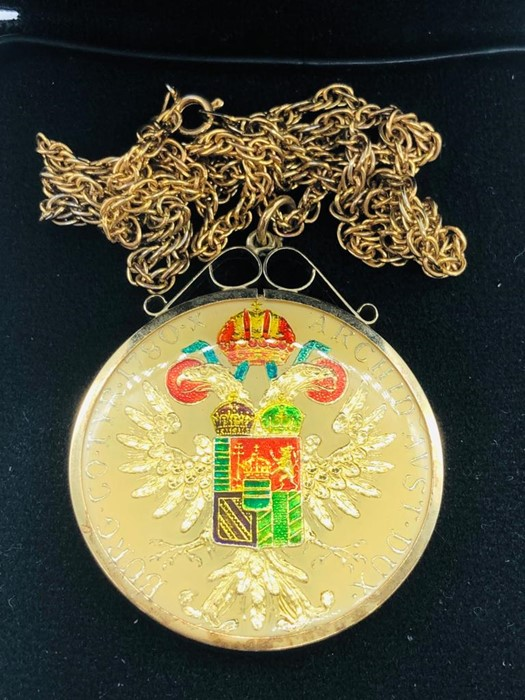 Lot 111 - A House of Broomfield hand enamelled coin on chain