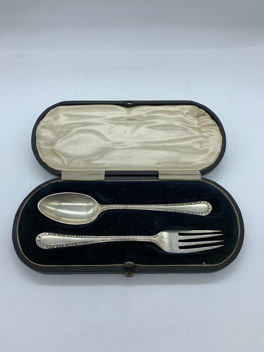 Lot 38 - A hallmarked silver boxed christening set, spoon and fork