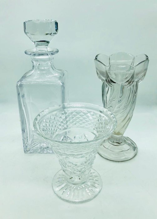 Lot 141 - A selection of cut crystal glass to include two celery vases and a decanter
