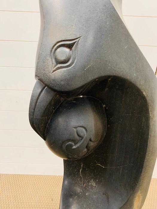 Lot 171 - A stone sculpture of a Bird with an egg