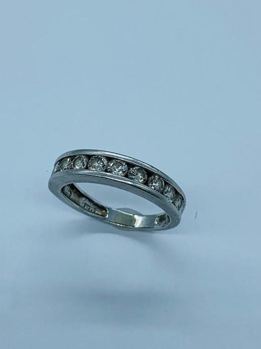 Lot 57 - A Platinum and diamond half eternity ring.
