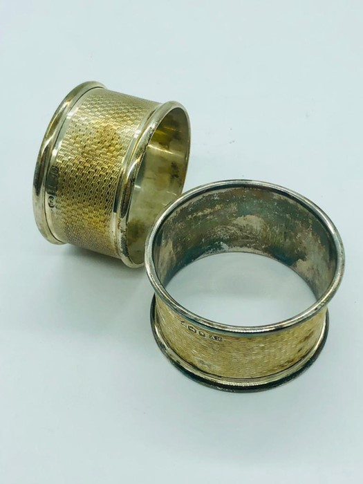 Lot 5 - Two Hallmarked silver napkin rings,boxed