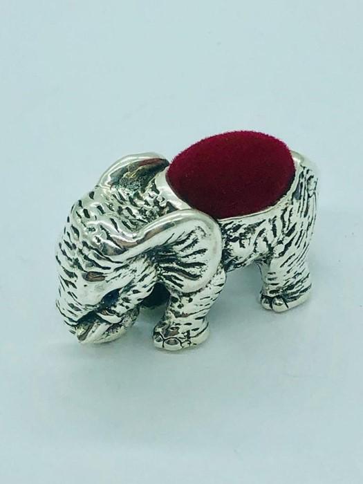 Lot 32 - A silver elephant pincushion