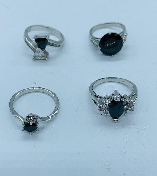 Lot 70c - A selection of four rings marked 10kt. (13.8g)