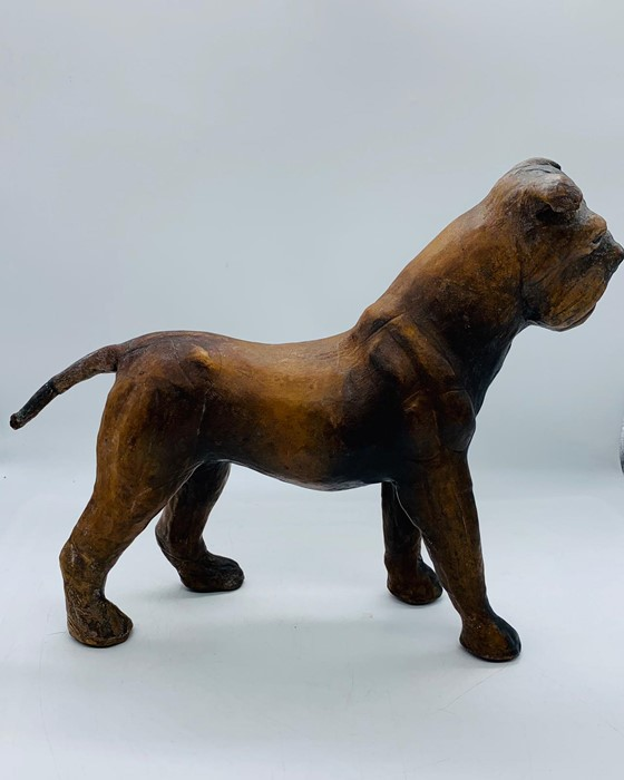 Lot 156 - A French Antique leather dog (25cm High and 35cm nose to tail)