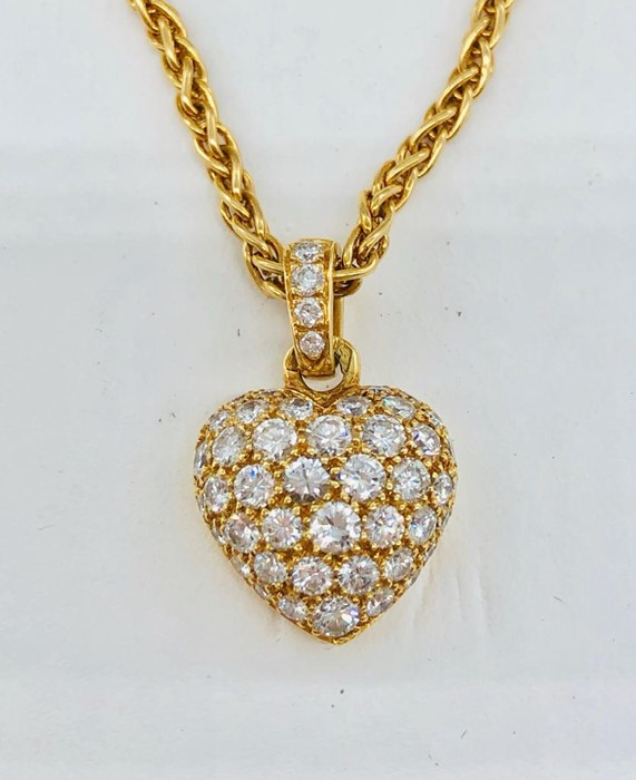 Lot 53 - A Cartier pave diamond heart on 18 ct gold chain in original box with paperwork.