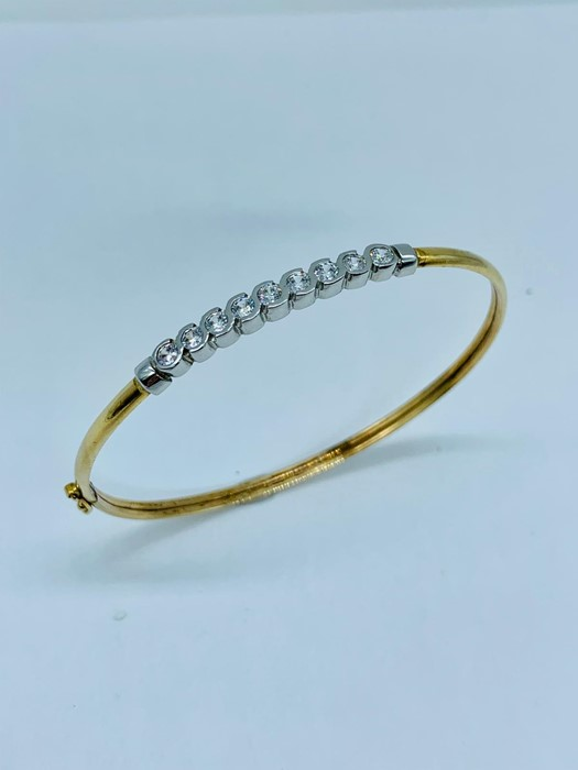 Lot 70 - A Persian gold Bracelet with white stones