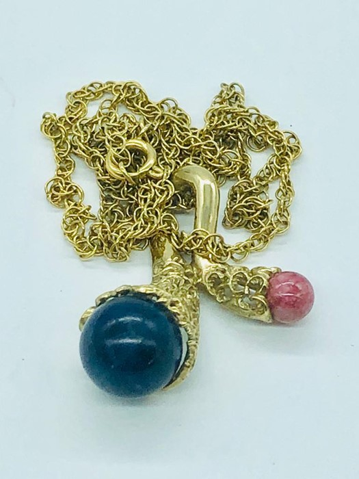 Lot 59 - A 9ct gold pendant and chain set with semi precious stones (total weight 11.05g)