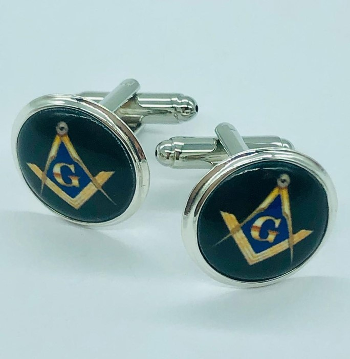 Lot 82 - A pair of silver and enamel cufflinks with masonic symbols