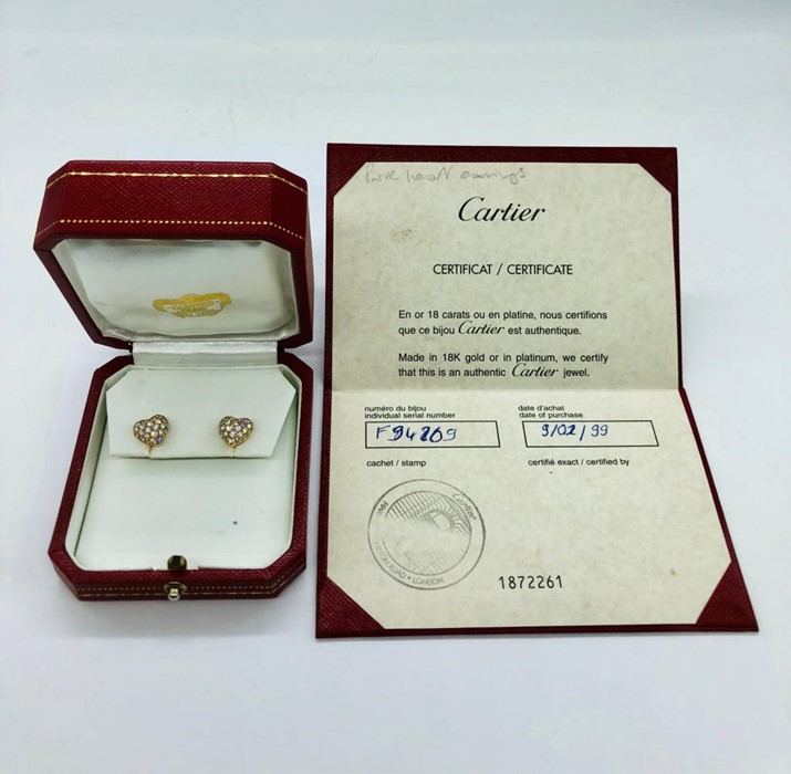 Lot 54 - A pair of Heart shaped Cartier earrings with pave diamonds in original box and with original