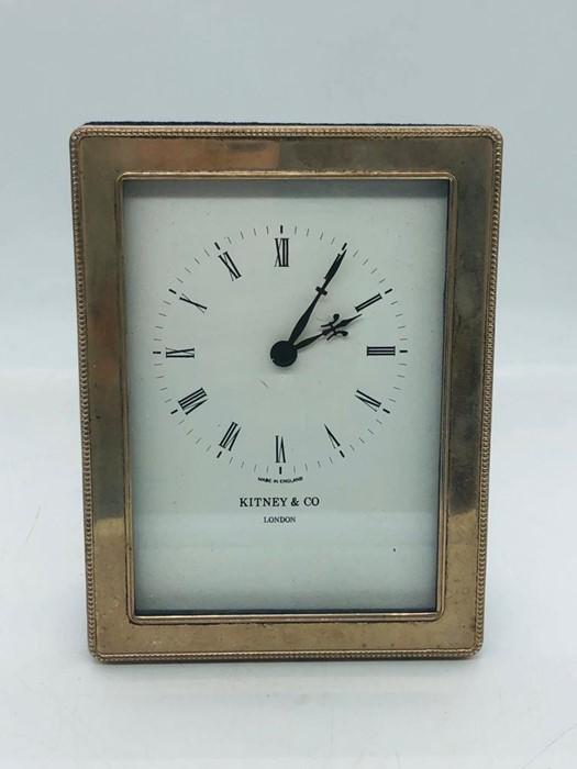 Lot 10 - A hallmarked silver Witney & Co clock.
