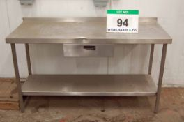 An 150cm x 60cm Stainless Steel Side Table fitted Single Drawer and Under Shelf (NOTE: Dent to
