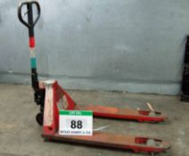 A Red Steel Manual Hydraulic Pallet Truck