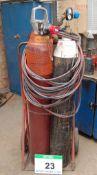 An Oxy-Acetylene Welding Set with Steel Twin Bottle Trolley Regulators, Hose and Lance (Bottles