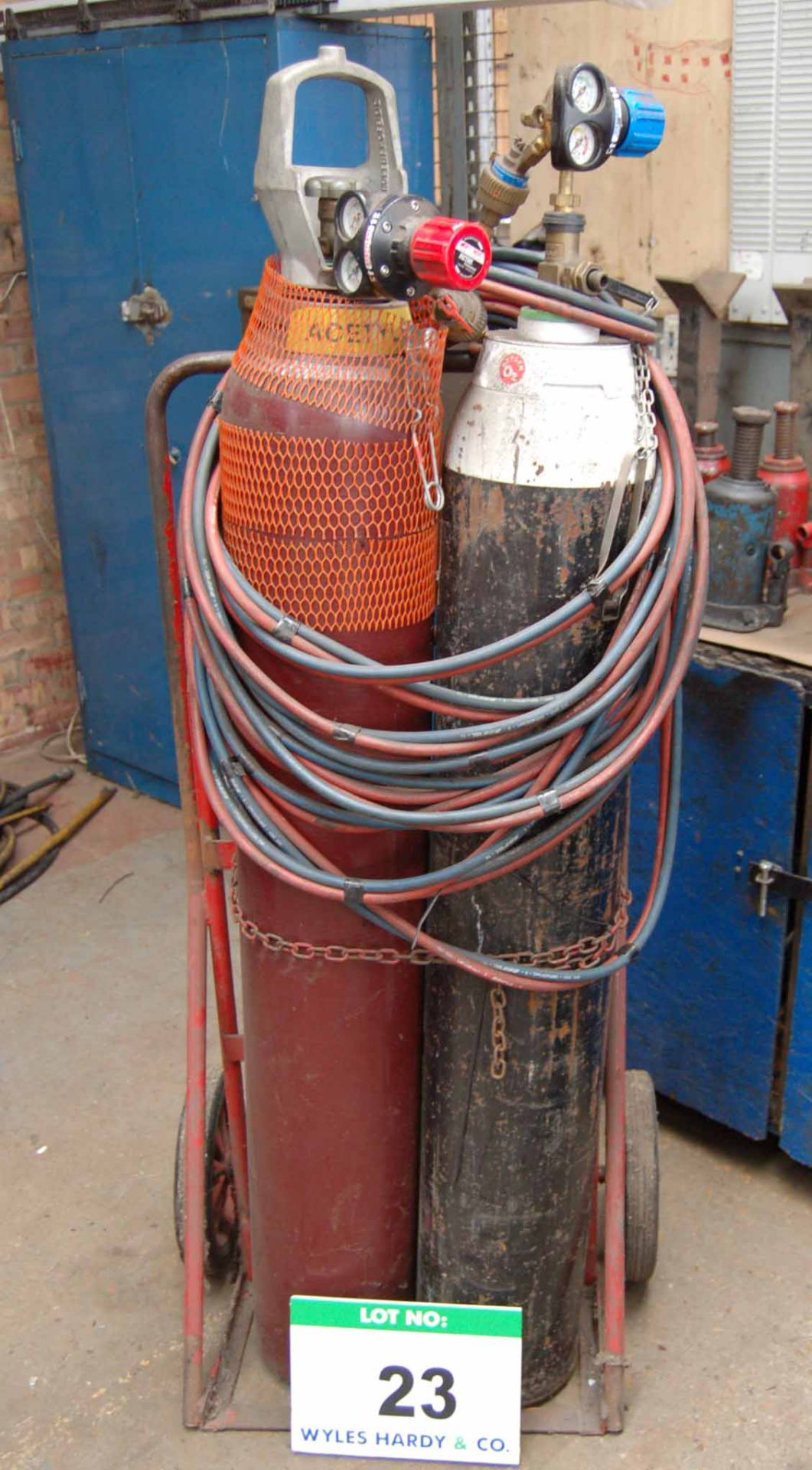 Lot 23 - An Oxy-Acetylene Welding Set with Steel Twin Bottle Trolley Regulators, Hose and Lance (Bottles