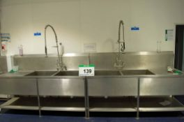 Two Stainless Steel Twin Pot Wash Sinks, each with Overhead Shower Lance (NOTE: Needs a Method