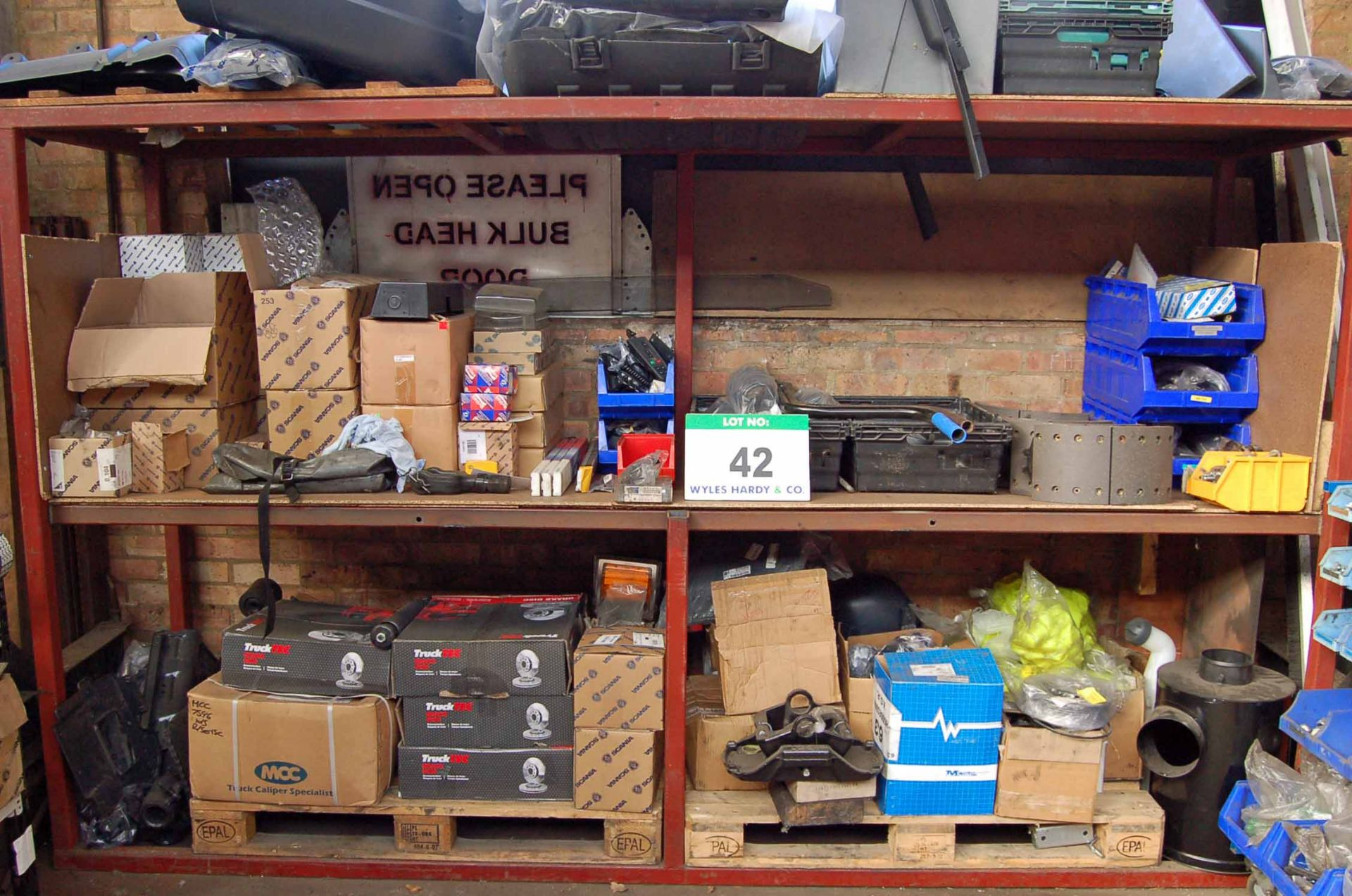 Lot 42 - A Steel 2-Tier Rack with Contents comprising A Quantity of Various SCANIA Truck Plastic Fittings,