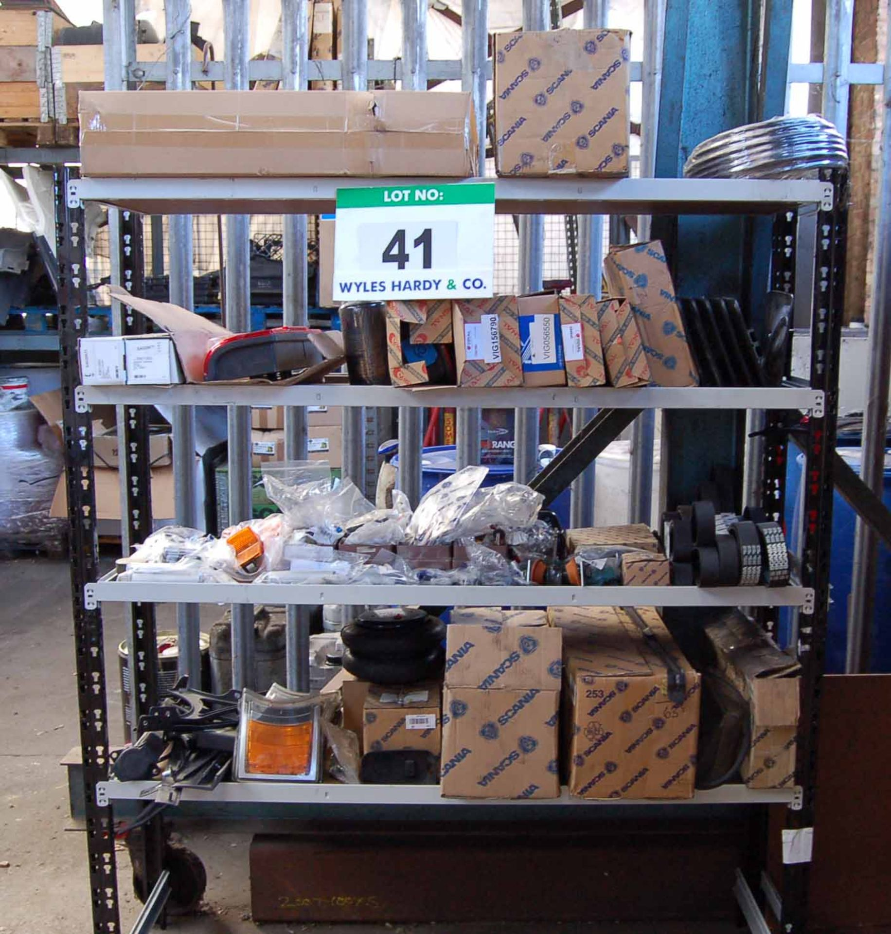 Lot 41 - A Steel 4-Tier Parts Rack with Contents comprising A Quantity of Various SCANIA Truck Light