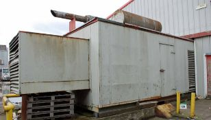 A Diesel Standby Generator Set, 500KVA Output, in Acoustic Housing with Roof mounted Exhaust,